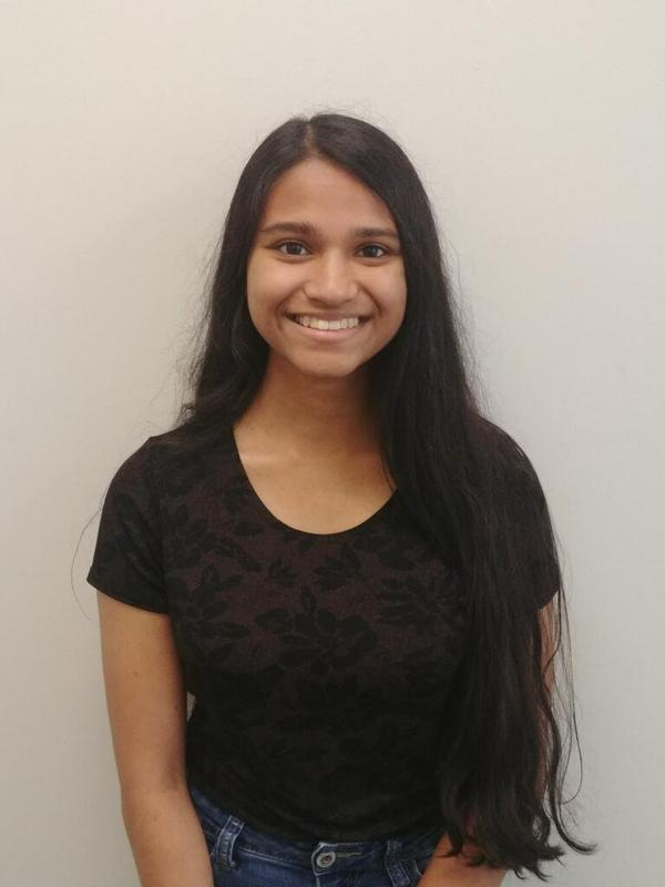 photo of Bensalem High School senior Tanvi who was recently named a National Merit Scholarship Commended student. She has long dark hair and a big smile on her face.