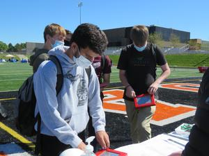 Students take part in an activity at the OAK Construction booth.