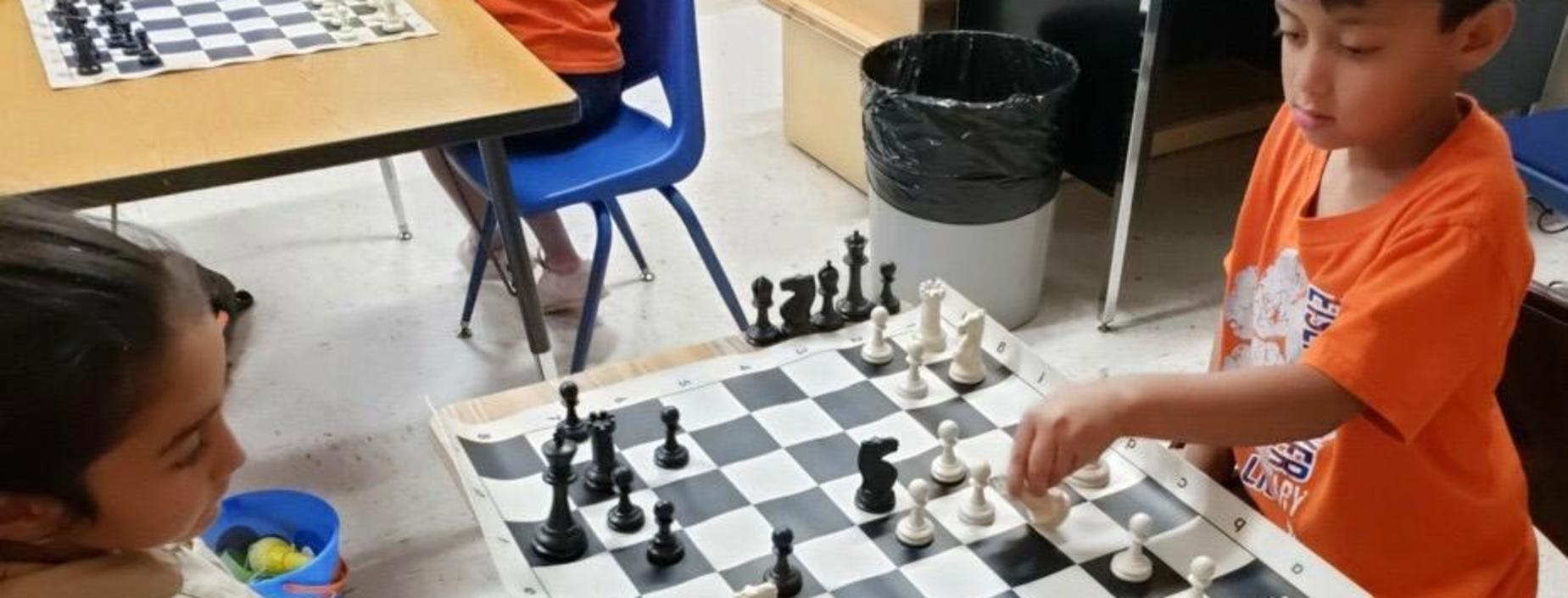 Image of students playing chess.