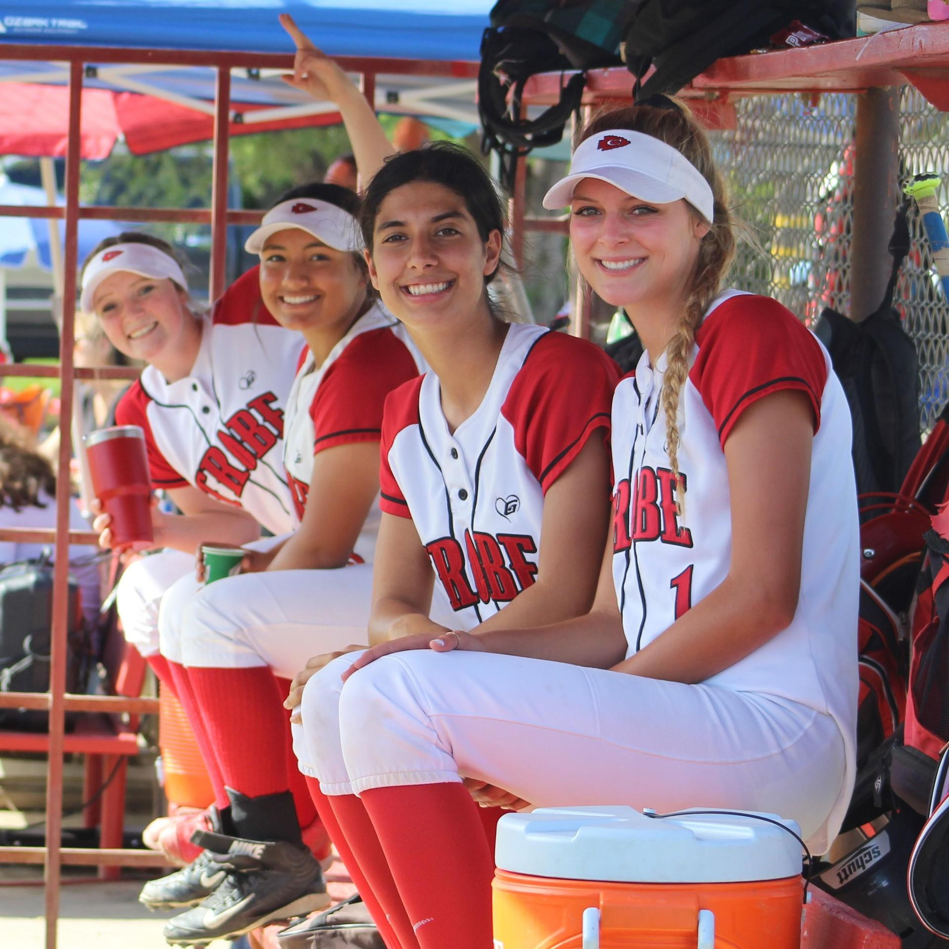 Tori Calley, Erykah Negron, Priscilla Foster and Kinsley Vlot in the dugout