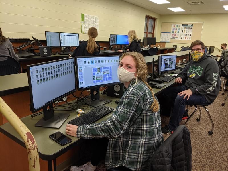 Students work on yearbook page layouts