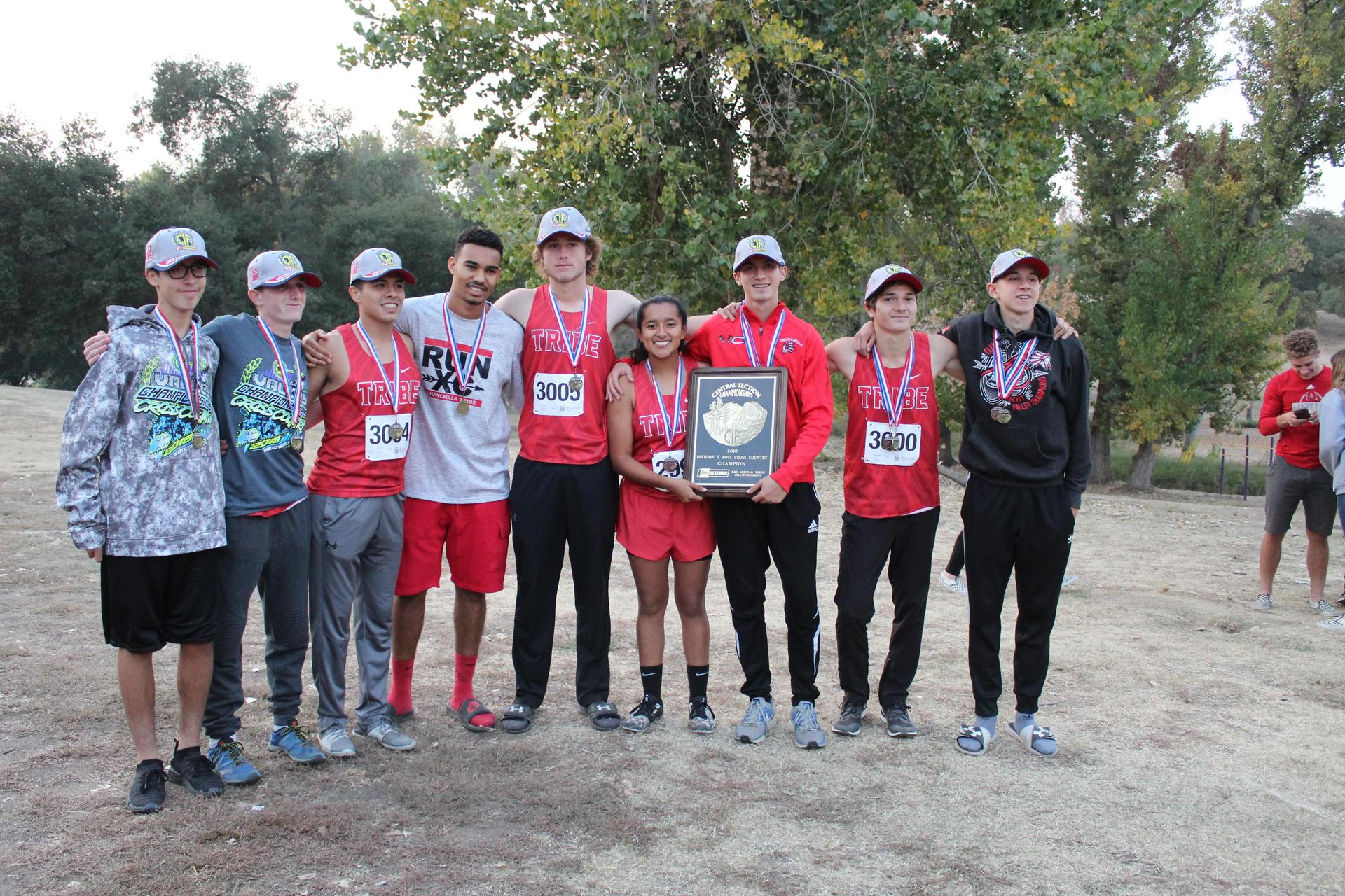 CUHS runners and coaches posing with the trophy.