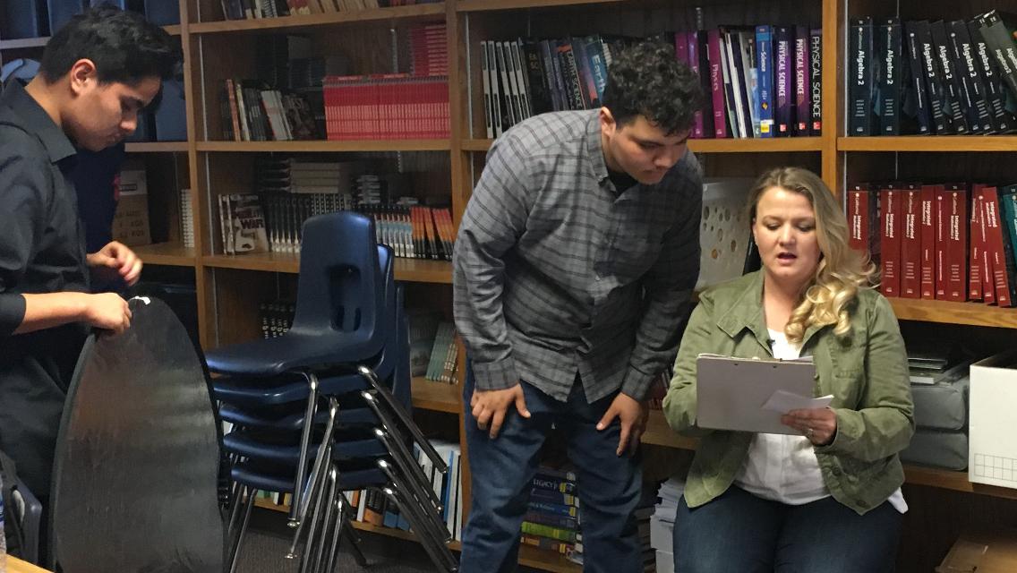Interviewing teachers from West High School.