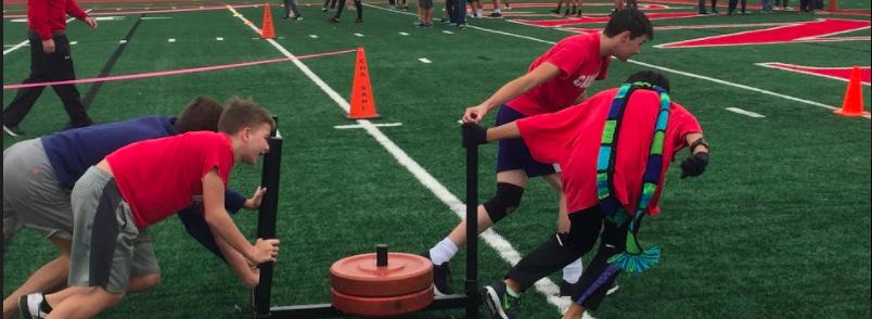 kids pushing weights