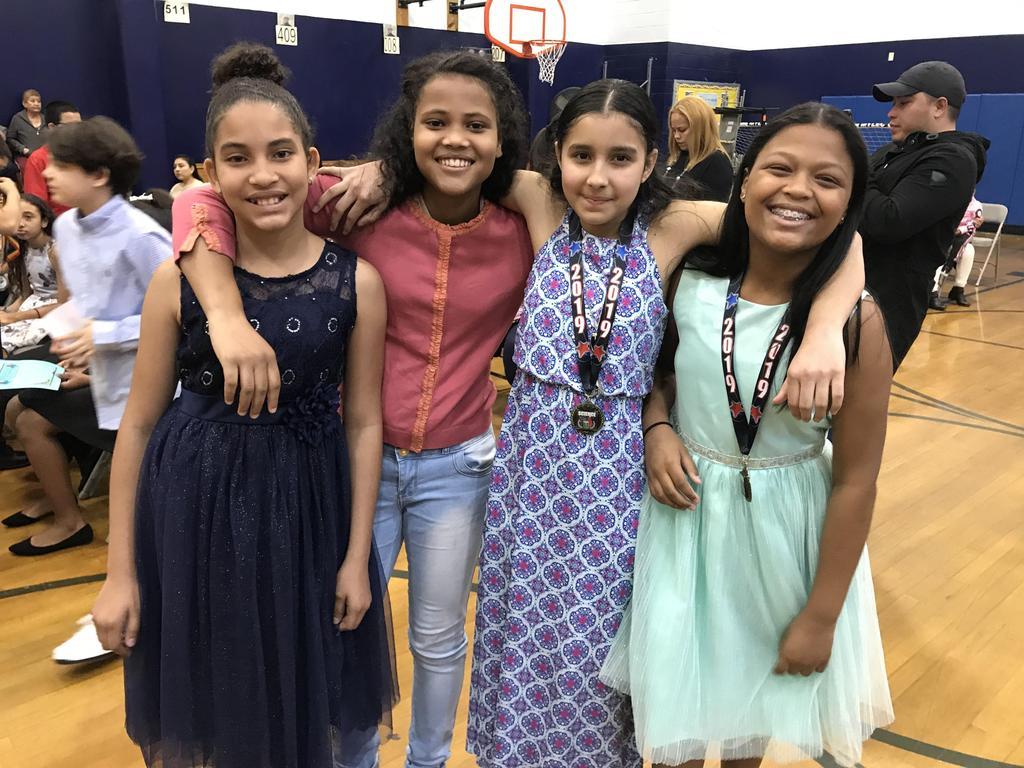 four girls sharing a hug together