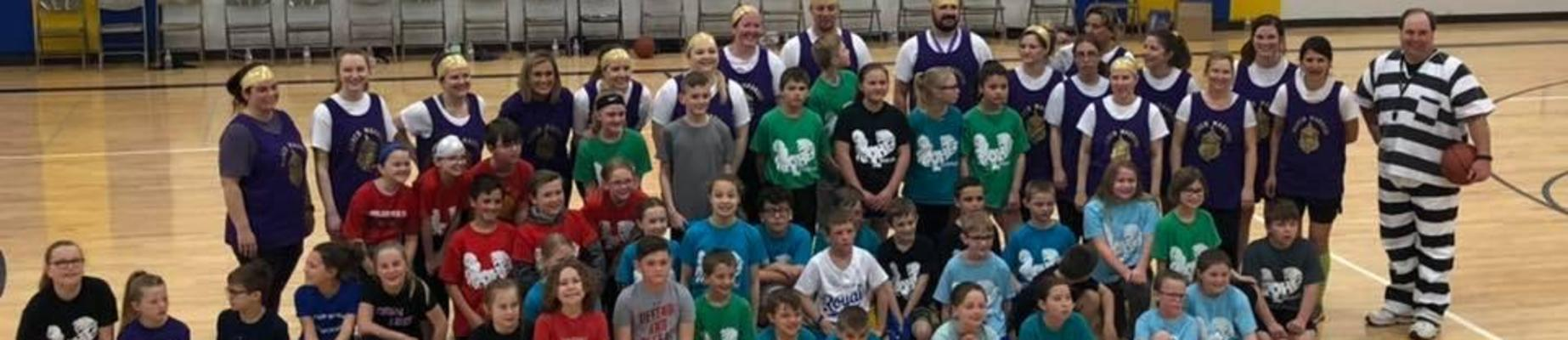 4th grade students and staff that played in March Madness basketball games against 4th grade