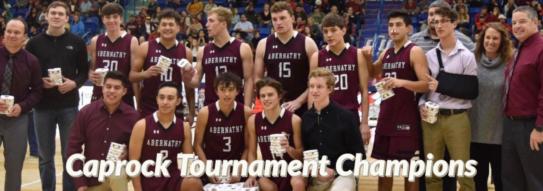 HS boys basketball team pose with their trophy