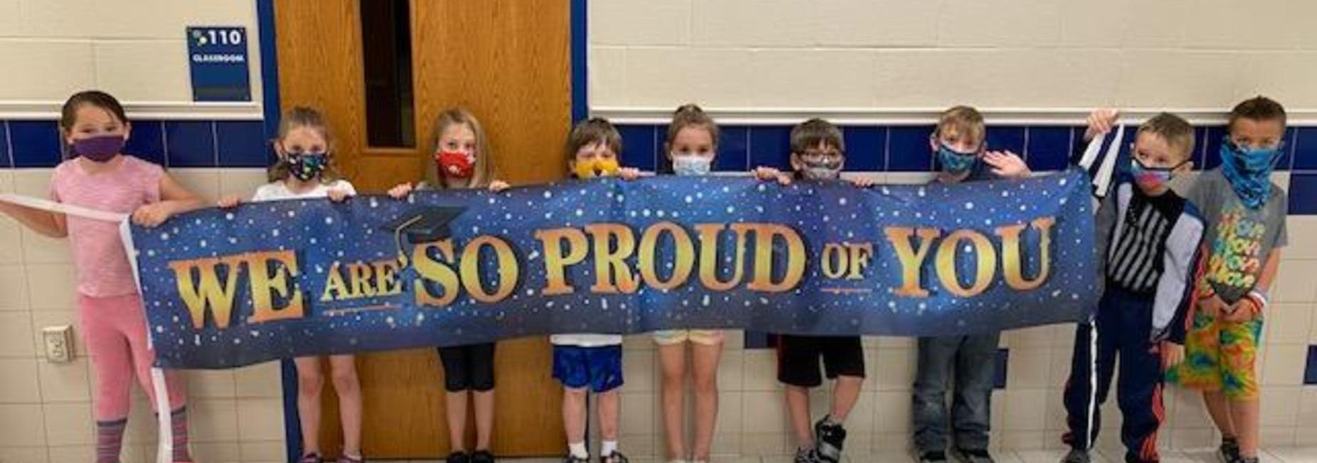 Kids holding up banner