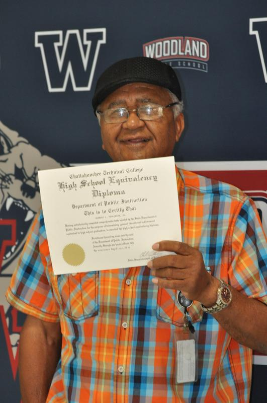Woodland Middle School custodian receives GED at 81-years-old