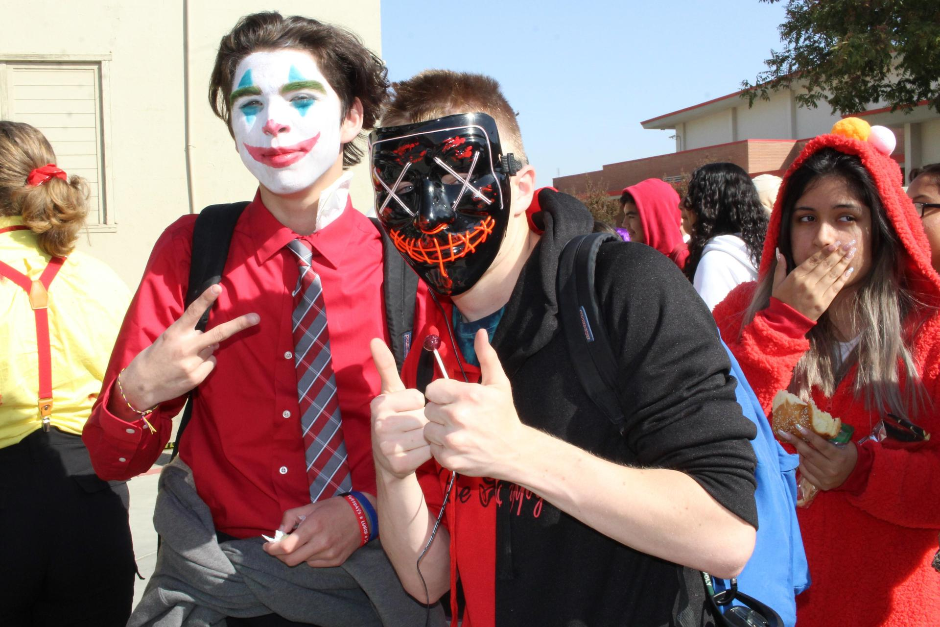 David Patino as the joker and Blake Kazynski as the purge with Mitzy Vasquez-martinez