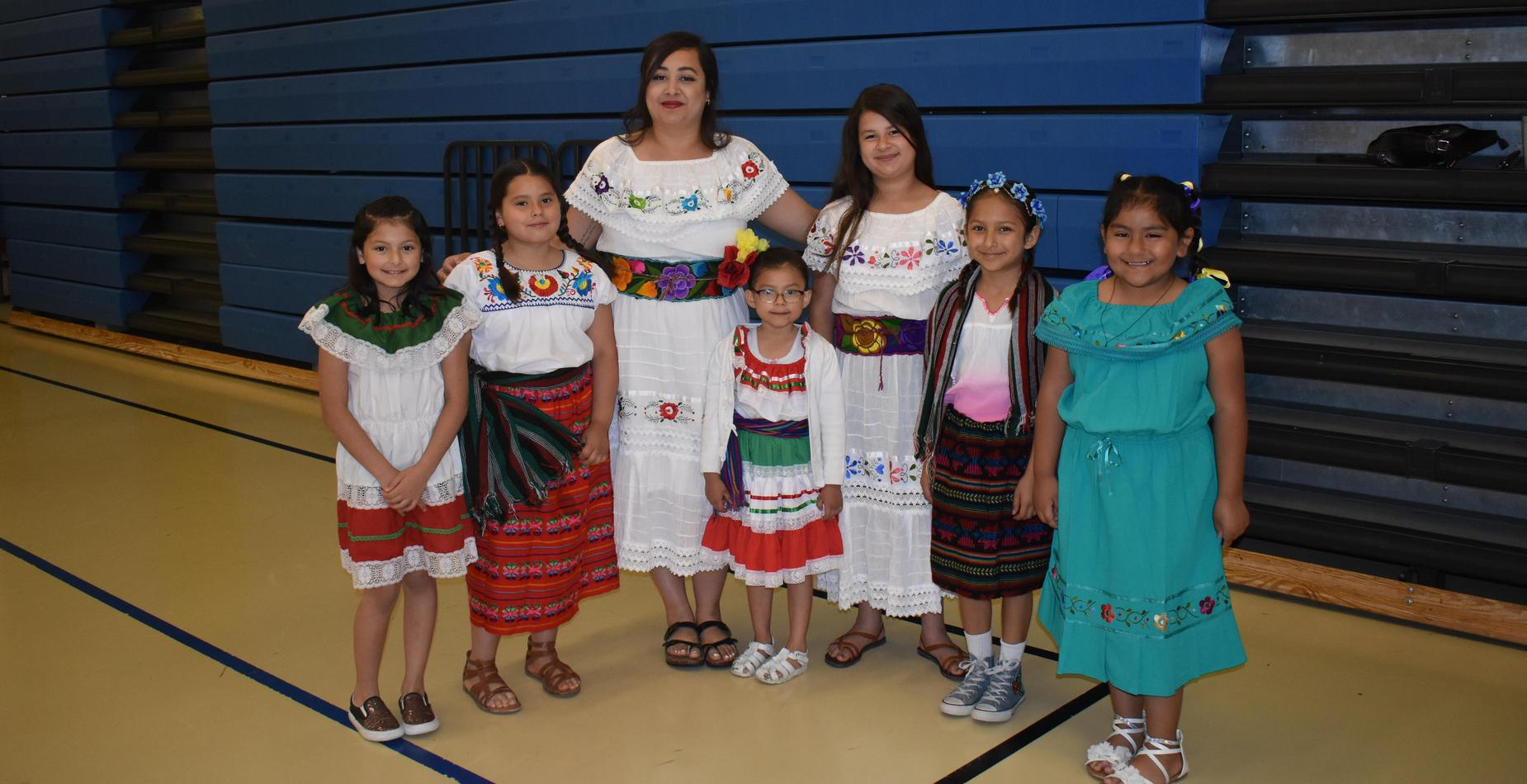 Seven girls dressed up for cultural dress day.