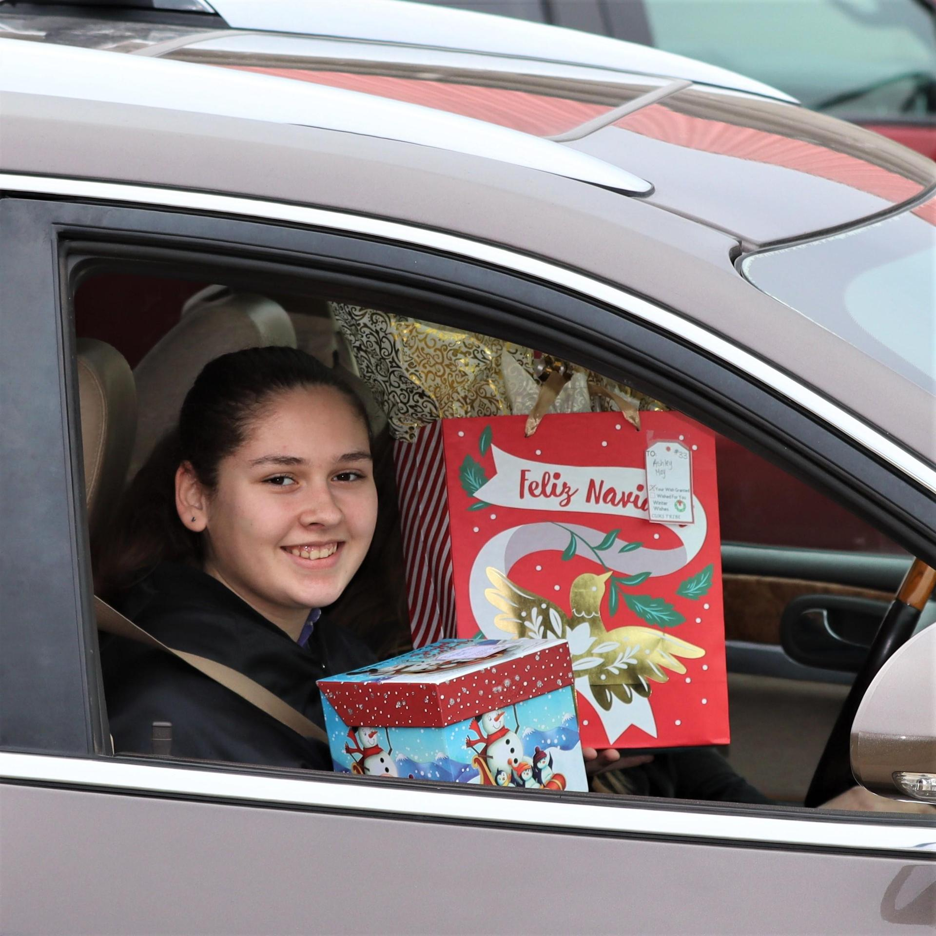 student with gift from Winter wishes
