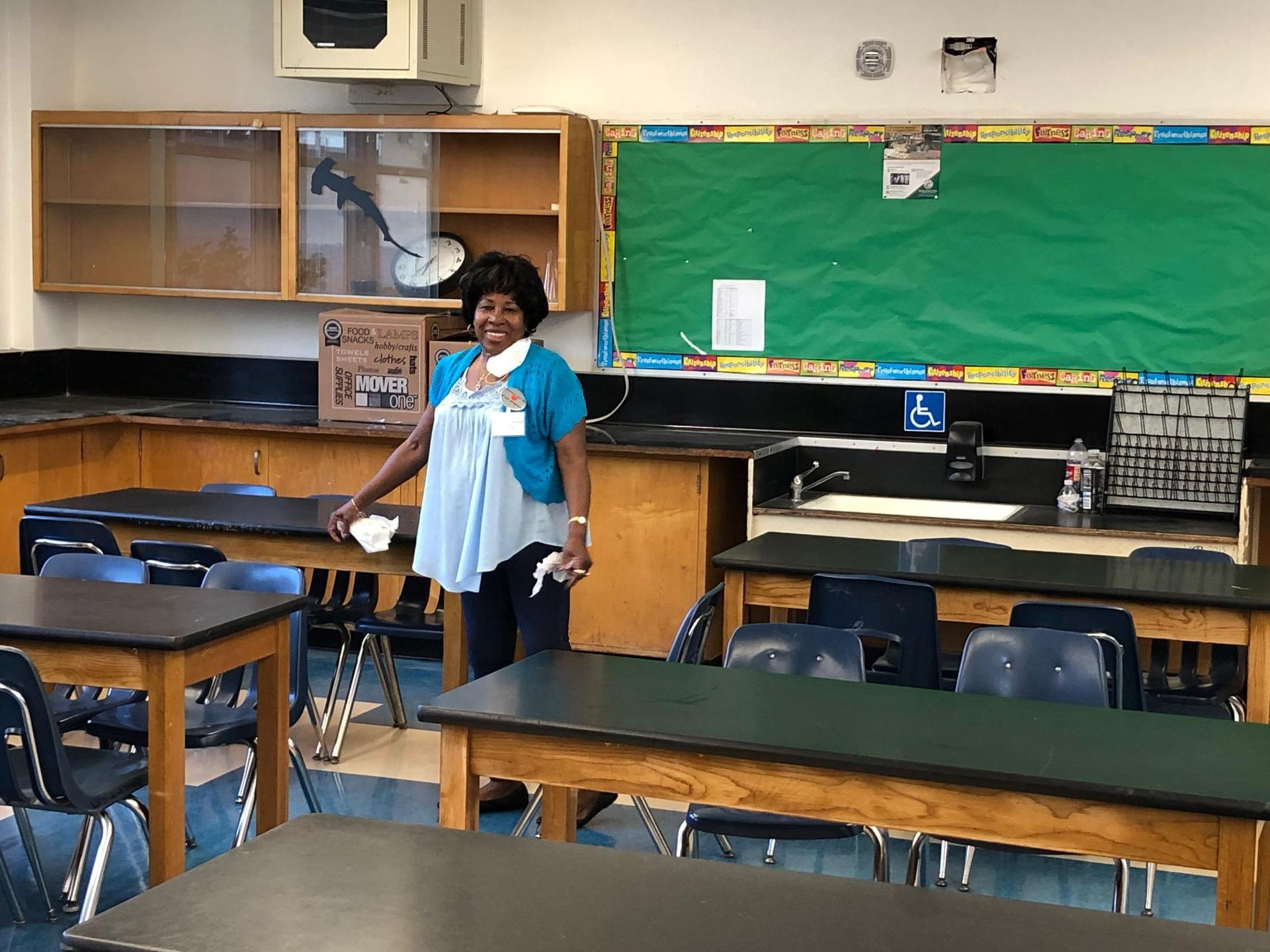 Mariner Makeover Crew cleaning classroom
