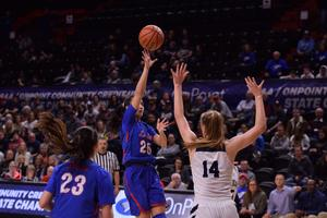 Alyson Muira floats one up to the basket