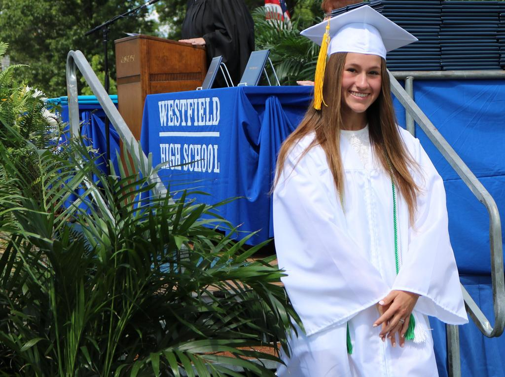 Photo of smiling WHS 12th grader during commencement ceremony.