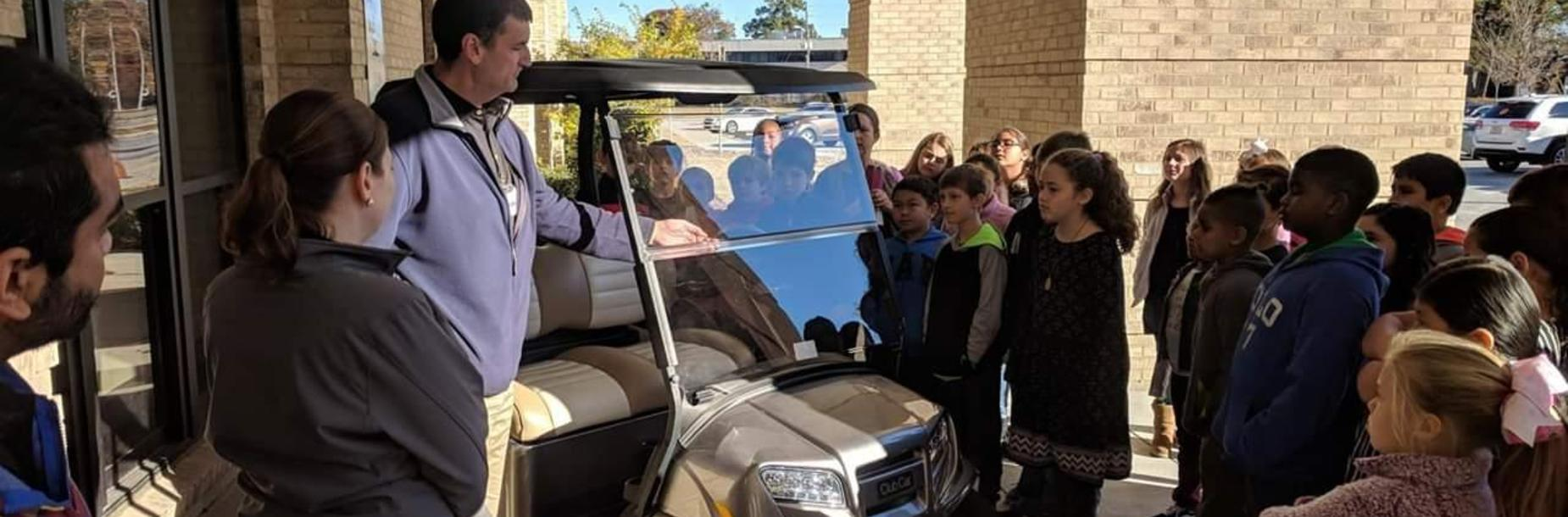 Club Car speaking with 4th grade students