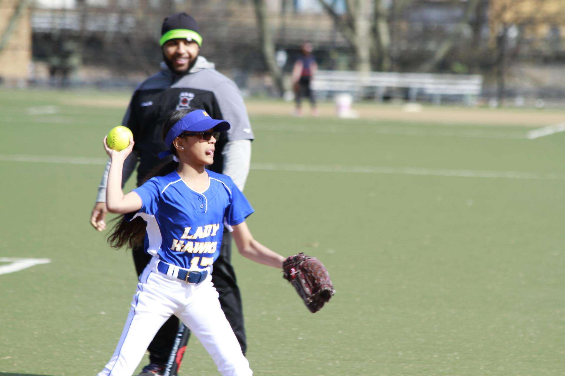 girl throwing a softball