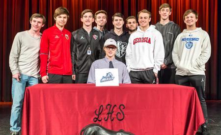 soccer team with Brendan Gribek at signing