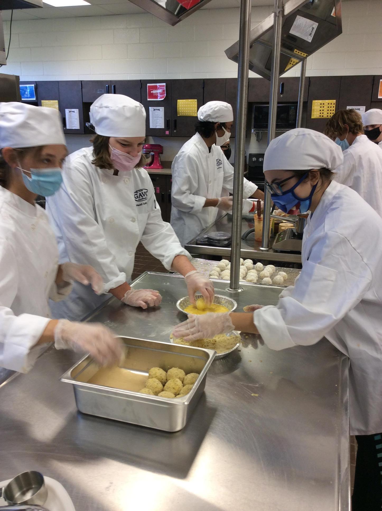 Culinary Arts students making pasta.