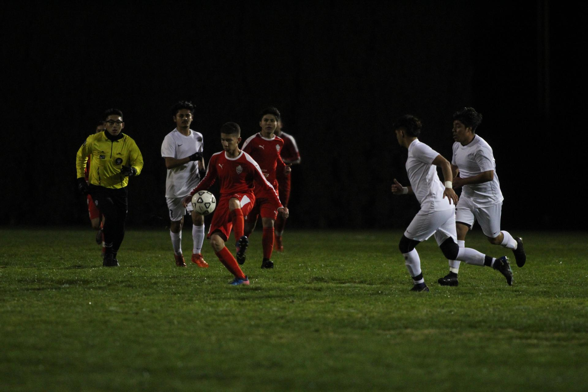 Boys playing soccer against Fresno.