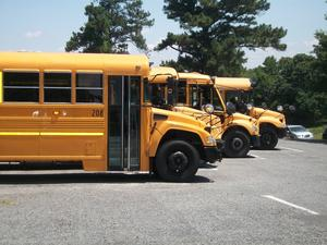 Buses parking in the parking lot.