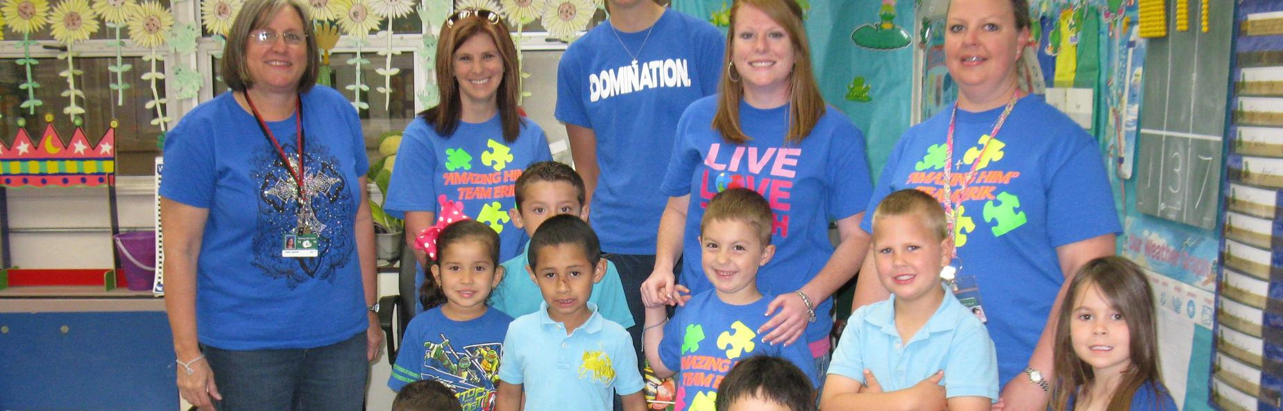 children and staff wearing blue to support autism awareness