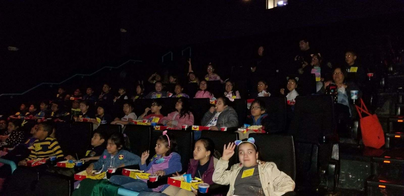 kids having snacks while watching the movie dumbo
