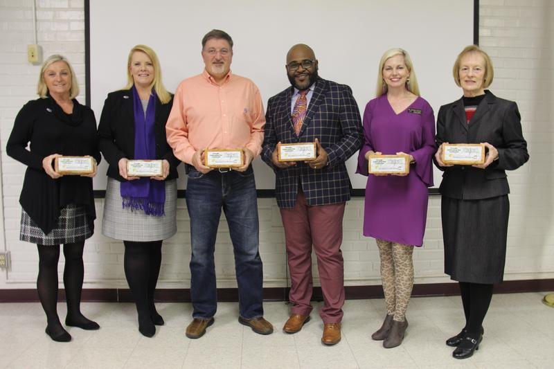 Current Lexington Three Board of Trustees members show off the commemorative bricks that they received on Tuesday, January 14th as part of the district's Centennial Celebrations and in honor of School Board Recognition Month. Pictured from left to right are: Cheryl Burgess, Stacey Derrick, Craig Caughman, Rev. Leon Drafts, Dr. Gariane Gunter and Frances Bouknight. Not pictured: Sonya Cary.