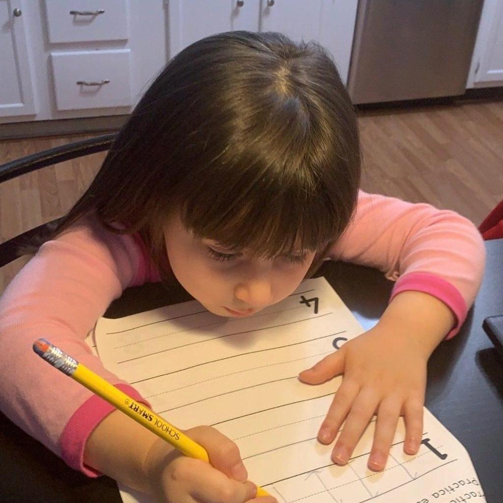 close up of a girl in her kitchen writing her numbers