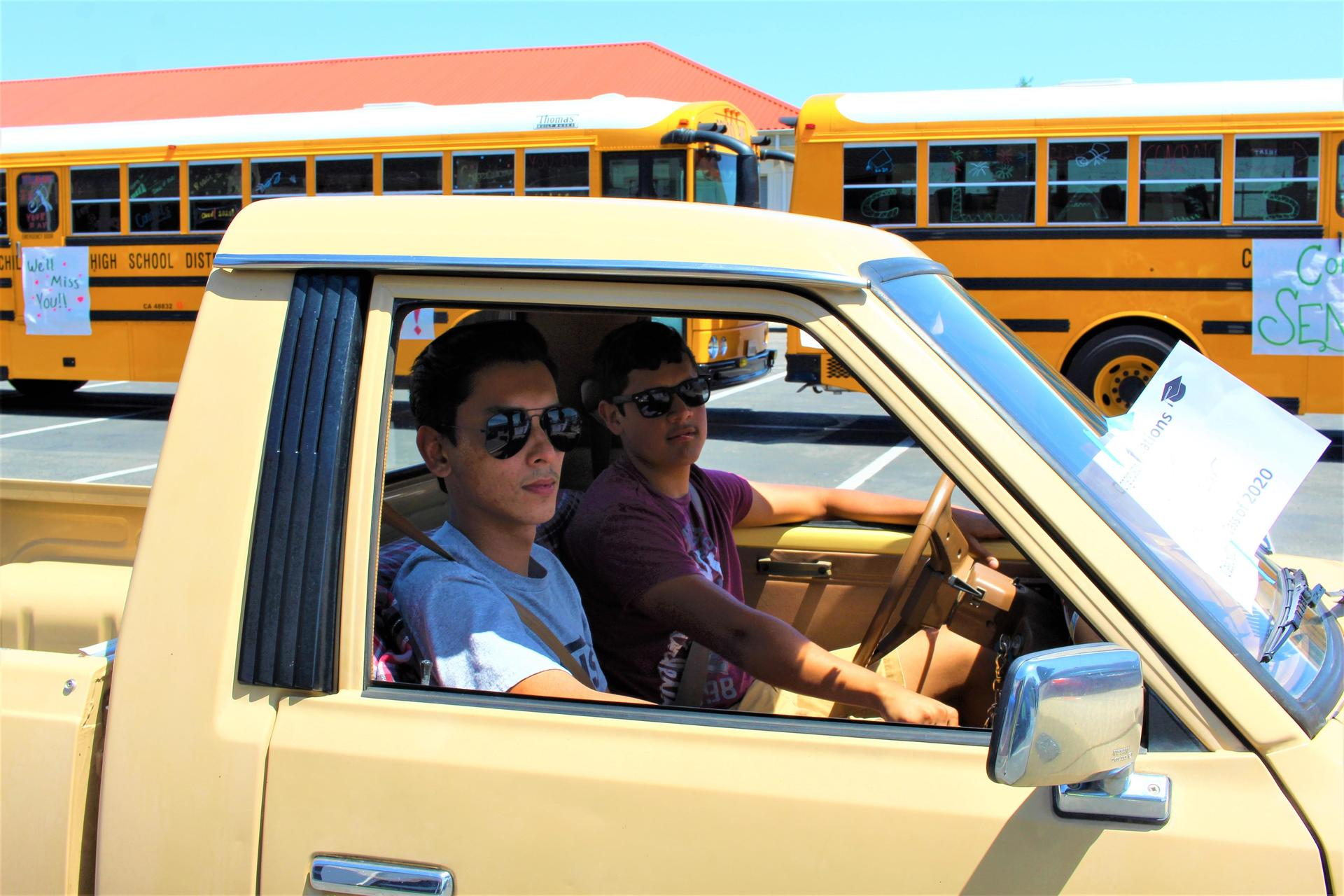 Nicholas Martinez riding with Oscar Salazar driving through