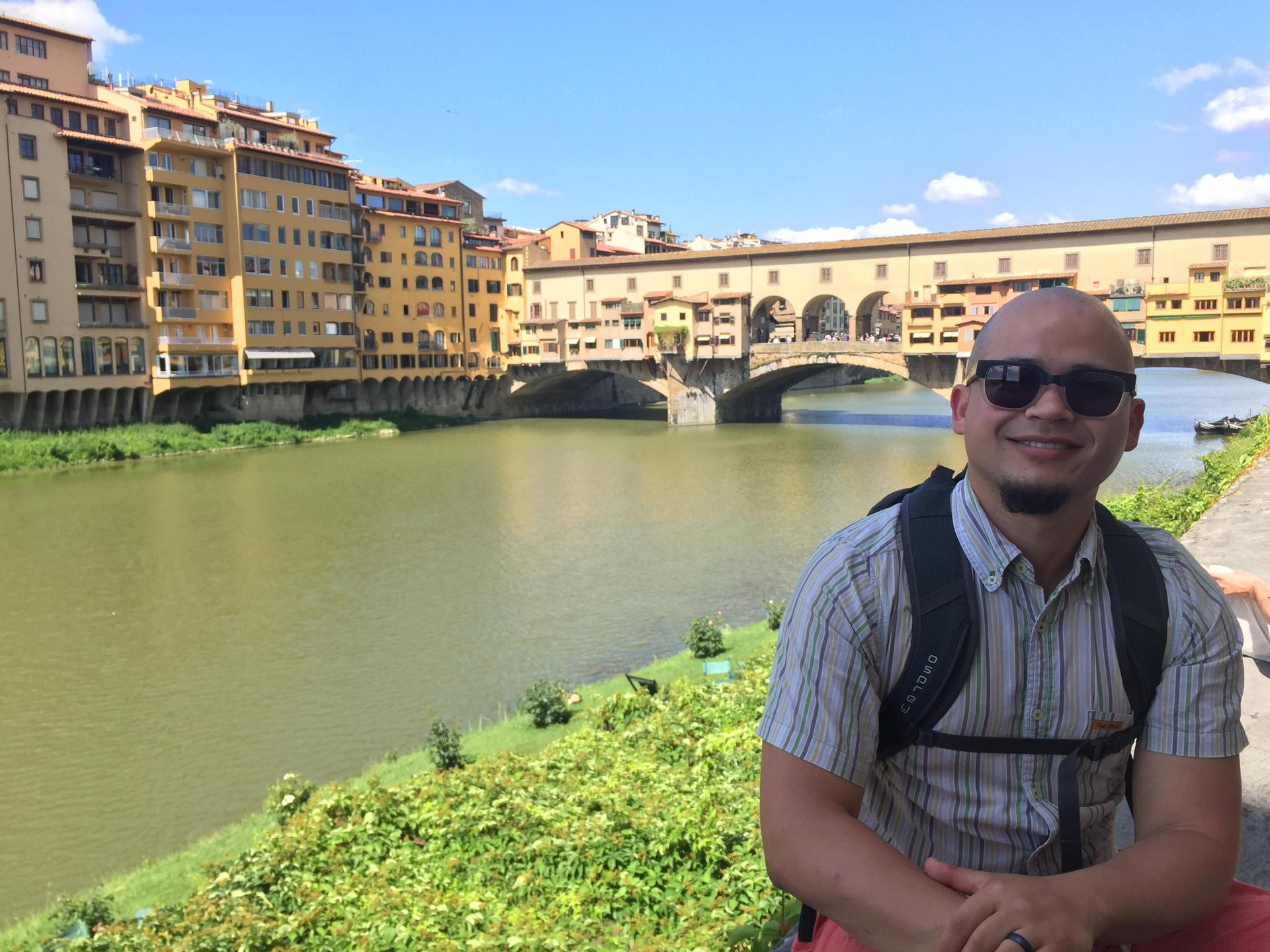 Mr. Palmer in front of a canal in Florence, Italy.