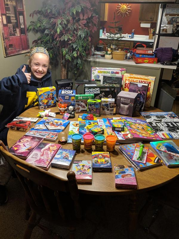 Madison Gates with toys she purchased with her charity money.