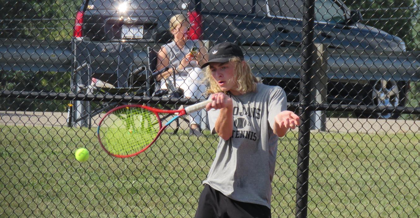TK varsity boy's tennis player makes a great return.