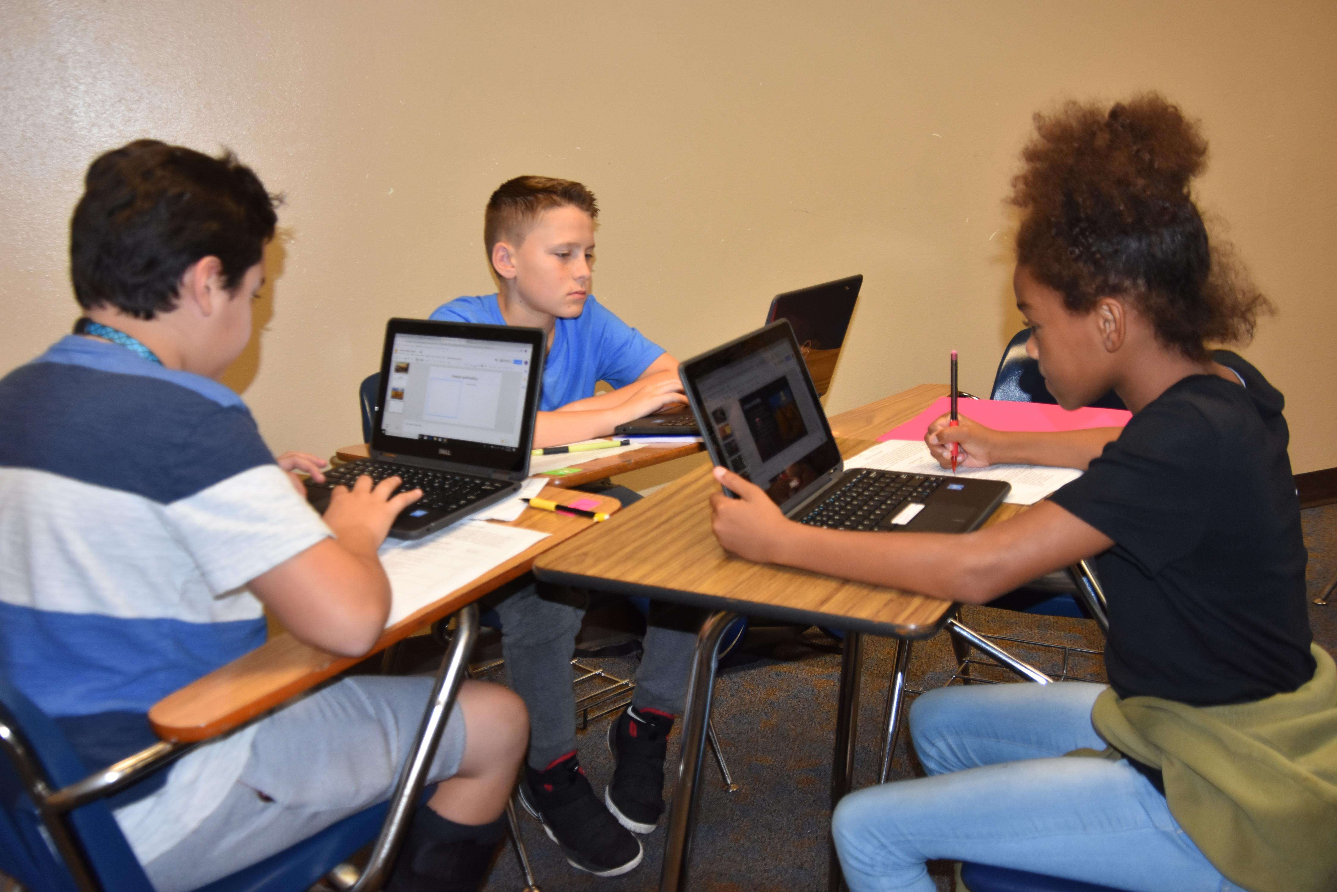 Brewer Middle School students use Dell laptops at school and at home to enhance learning.