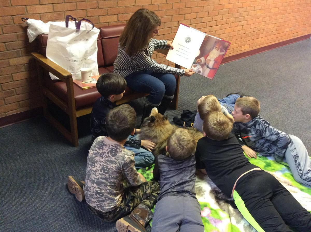 Learners reading book