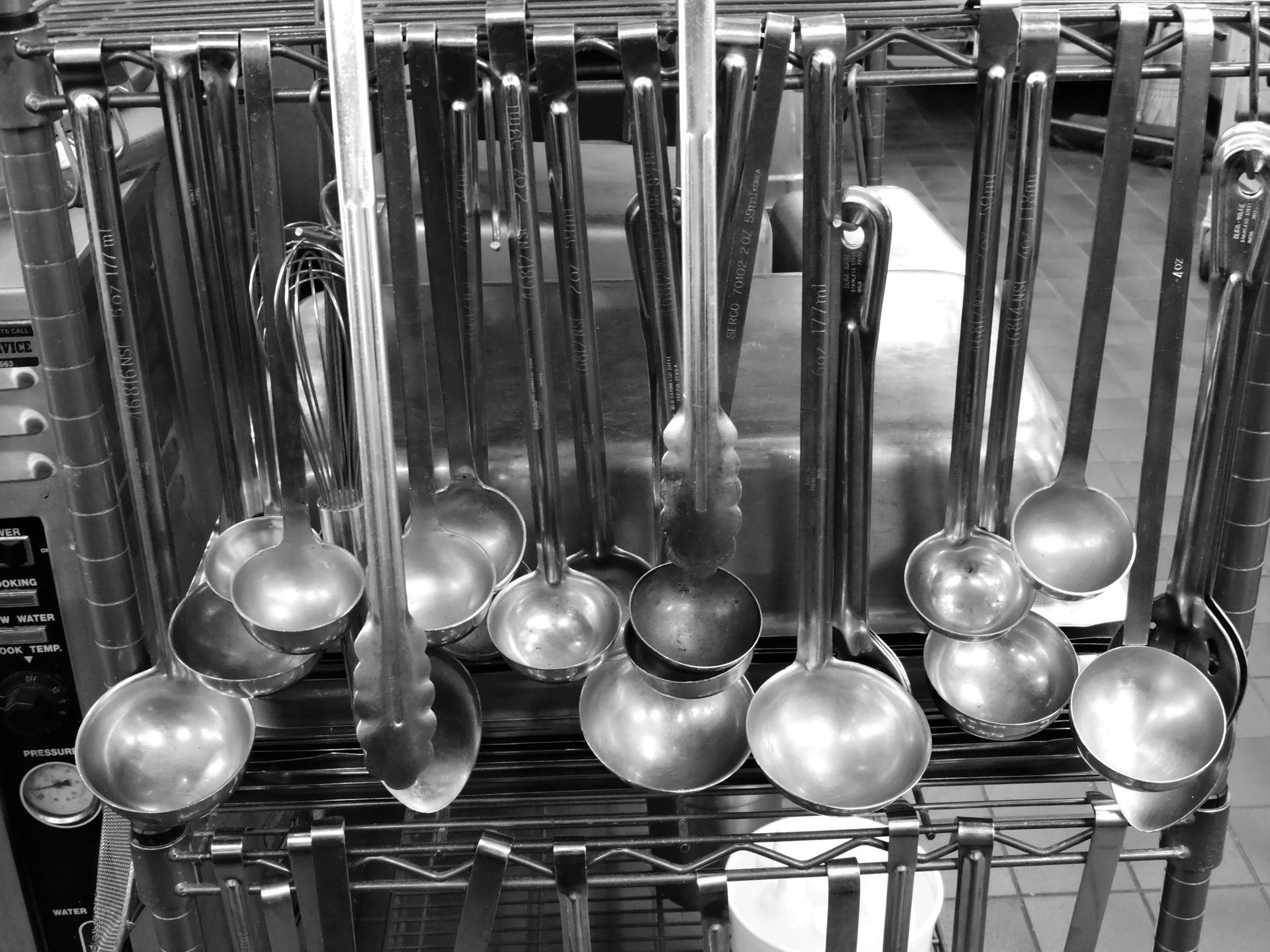 Ladles hanging from a rack