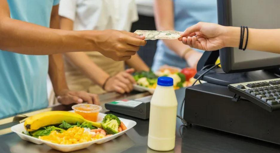 Student paying for meals picture