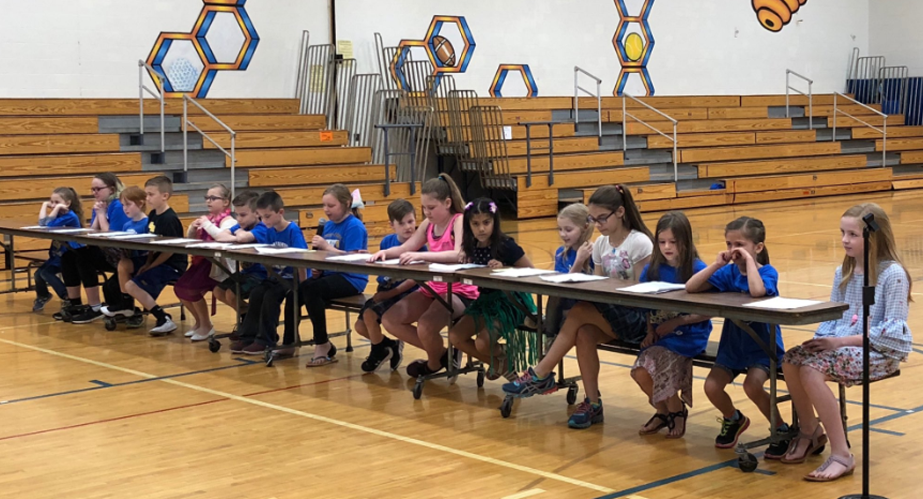 Leadership day, students sitting at a table in gym