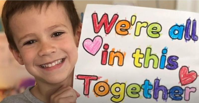 Photo of kindergartner holding