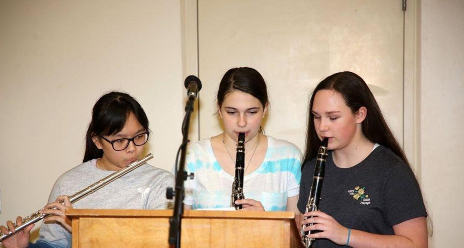 Sandstone Students playing musical notes.