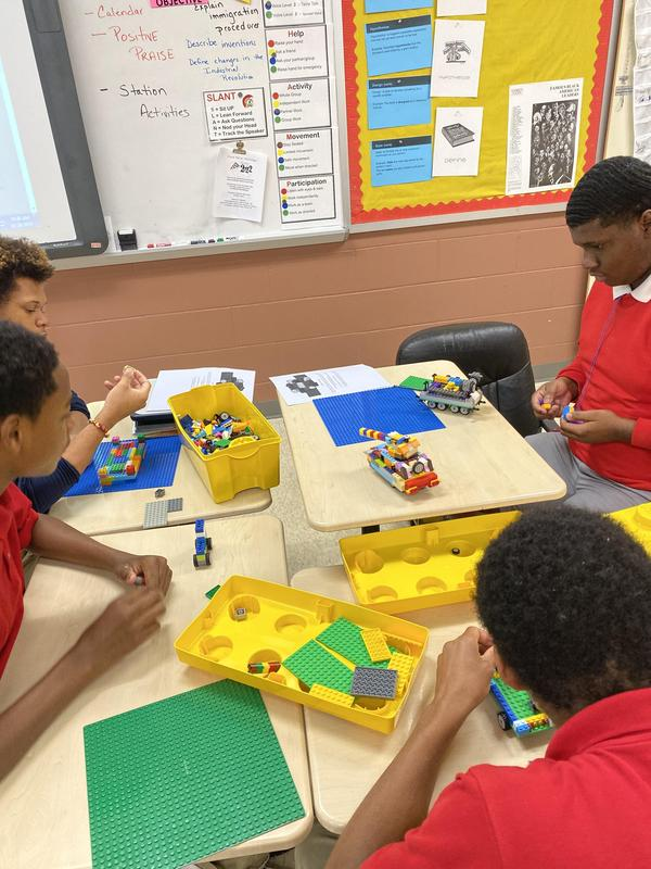 Students creating lego inventions