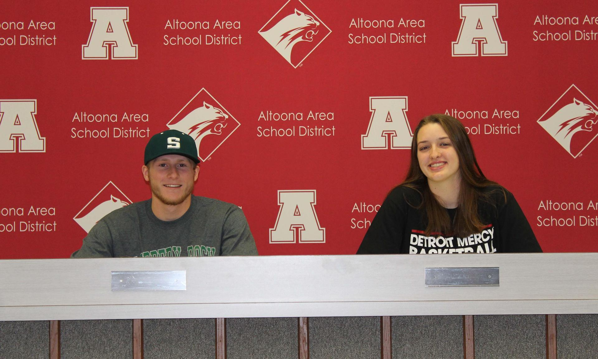 Matt Hartman and Bridgid Fox college signing
