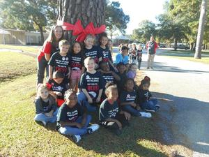 Photo of elementary students wearing Red Ribbon week t-shirts