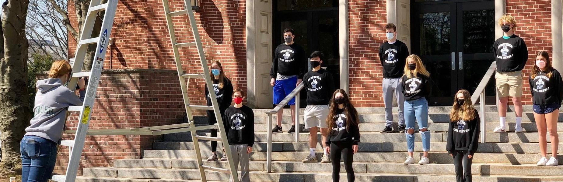 WHS seniors who attended Lincoln School's inaugural kindergarten classes in 2008-09 recently gathered outside of WHS for a special commemorative photo session.