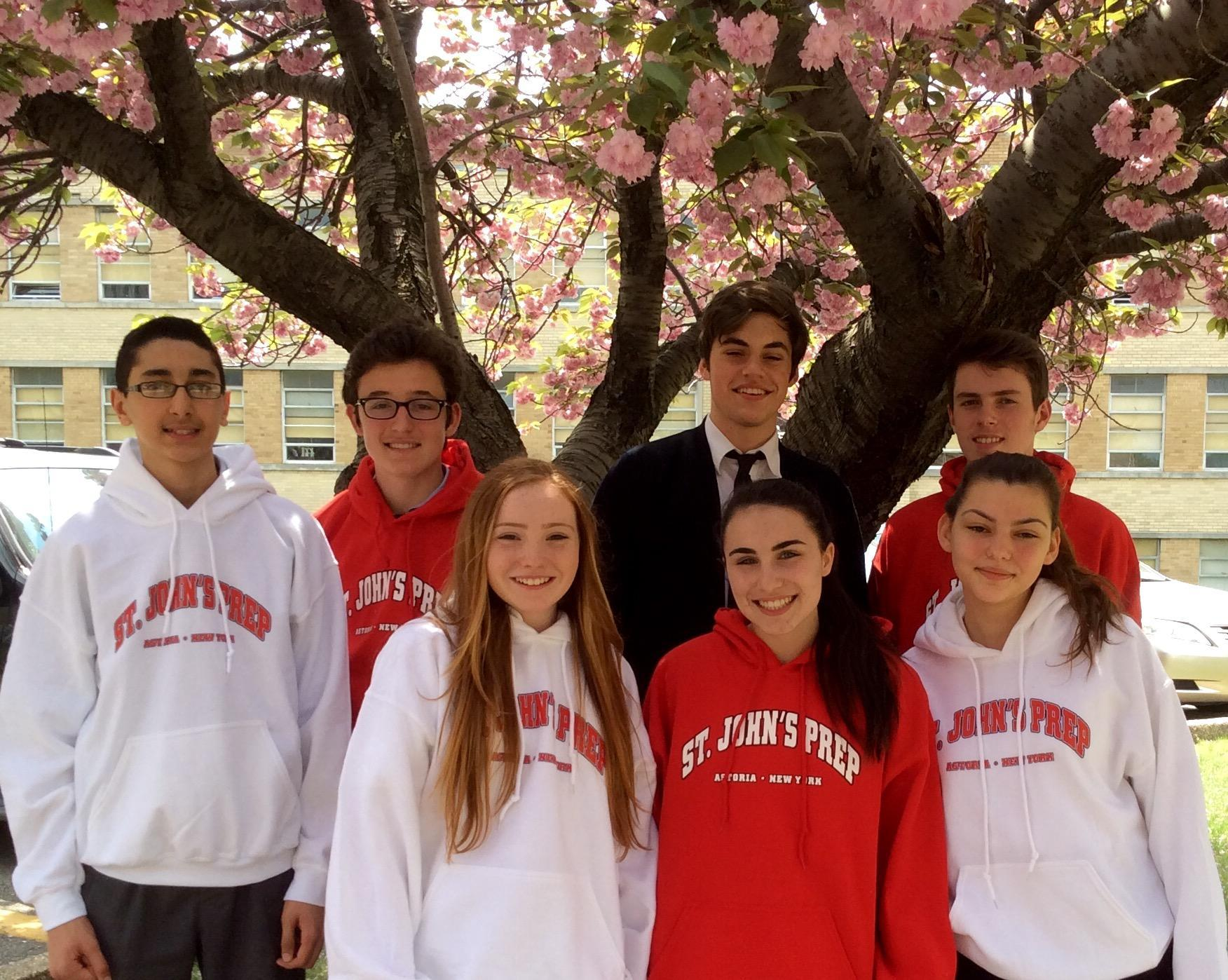 St. John's Prep students under tree