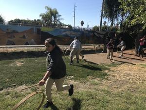 students having a hoop race
