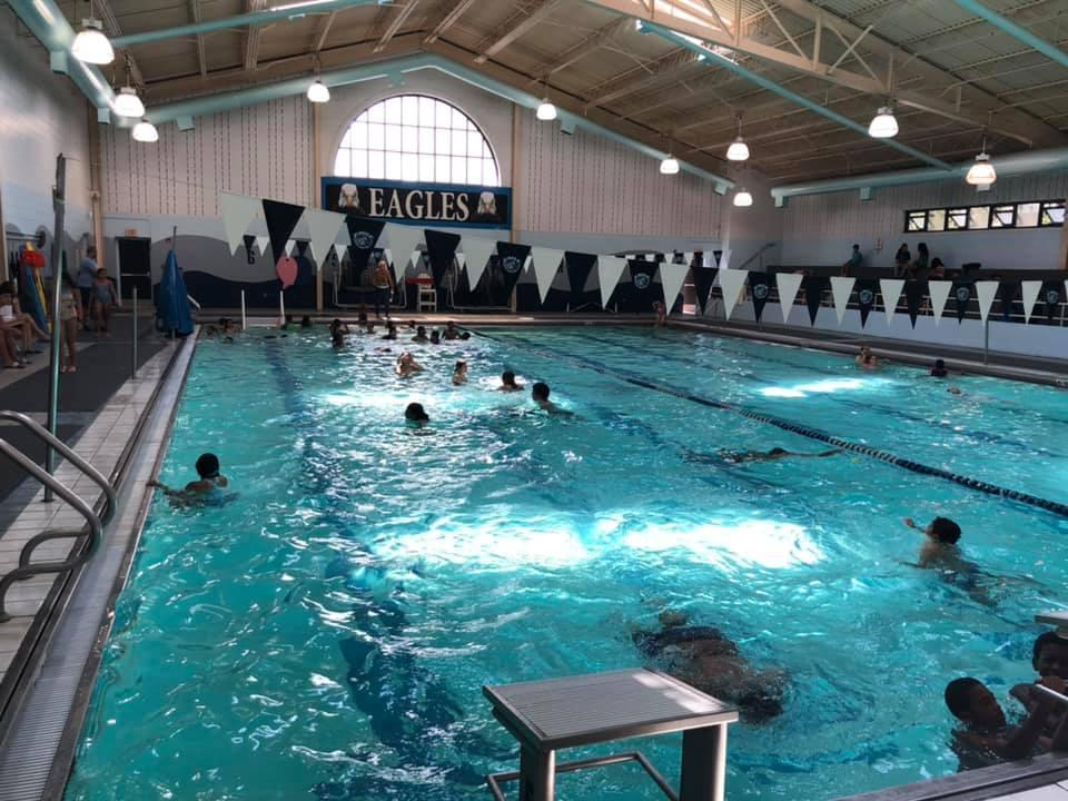 students swimming in the indoor pool