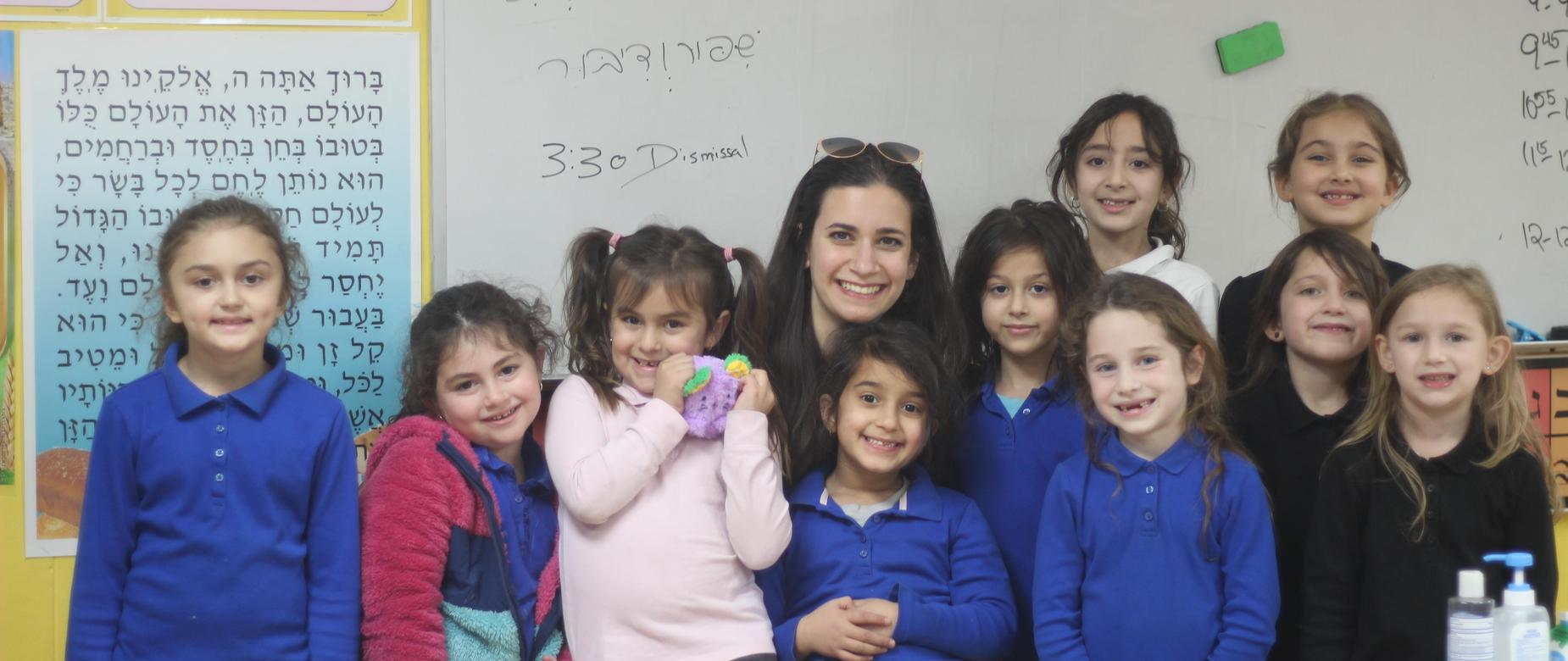Teacher posed with students