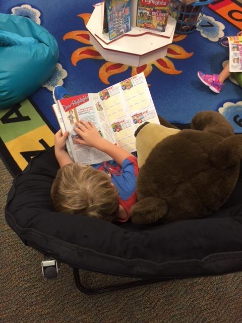 Reading with a Teddy bear