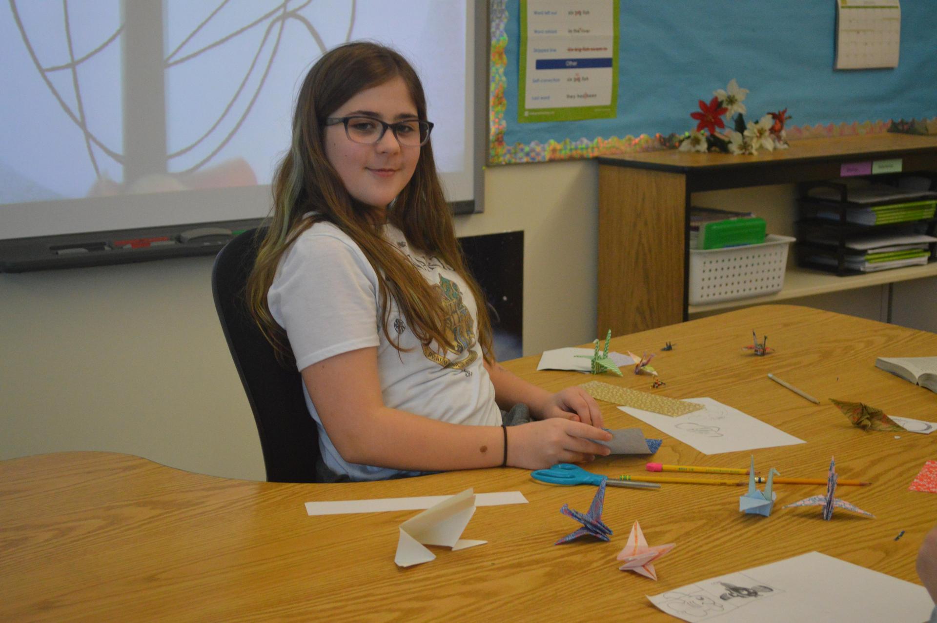 student creating origami